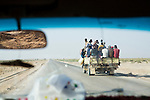 Yemeni men crammed into the back of pickup truck on road to Al Ghaydah, Yemen