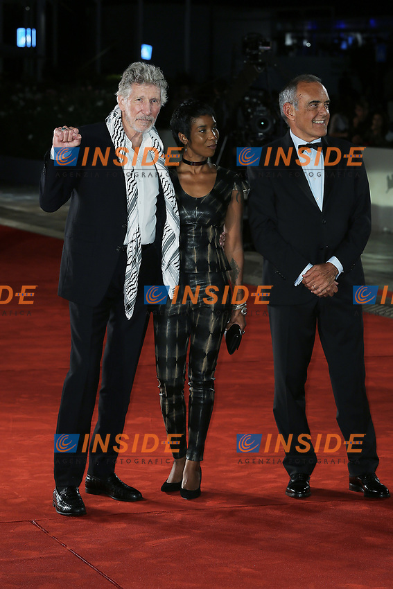 """VENICE, ITALY - September 06: (L-R) Roger Waters, a guest and Alberto Barbera attend """"Roger Waters Us + Them"""" Red Carpet during the 76th Venice Film Festival  on September 06 , 2019 in Venice, Italy. (Photo by Mark Cape/Insidefoto)<br /> Venezia 06/09/2019"""