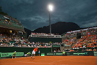 Austria, Kitzb&uuml;hel, Juli 17, 2015, Tennis, Davis Cup, Second match between Robin Haase (NED and Andreas Haider-Maurer (AUT), pictured : Robin Haase serves while a thunderstorm moves over and play gets suspended<br /> Photo: Tennisimages/Henk Koster