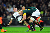 Andy Ellis of the Barbarians is double-tackled. Killik Cup International match, between the Barbarians and South Africa on November 5, 2016 at Wembley Stadium in London, England. Photo by: Patrick Khachfe / JMP