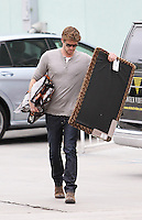 Domestic and down to earth! Hunky Liam Hemsworth spotted shopping 2 bags of dog food and a door mat in Studio City today. Los Angeles, California on 01.05.2012..Credit: Correa/face to face.. /MediaPunch Inc. ***FOR USA ONLY*** **SOLO*VENTA*EN*MEXICO**