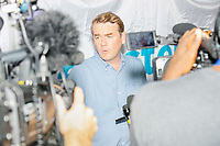 Democratic presidential candidate Michael Bennet speaks to the press after speaking at the Political Soapbox at the Iowa State Fair in Des, Moines, Iowa, on Sun., Aug. 11, 2019.