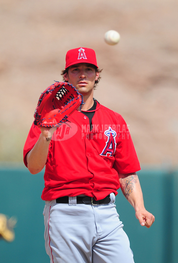 Mar. 4, 2012; Phoenix, AZ, USA; Los Angeles Angels pitcher C.J. Wilson against the Oakland Athletics during a spring training game at Phoenix Municipal Stadium.  Mandatory Credit: Mark J. Rebilas-