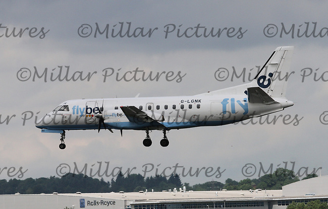 A Flybe Airways operated by Loganair Saab 340B Registration G-LGNK taxiing landing from Manchester Airport at Glasgow Airport on 3.7.15.