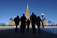 People make their way towards the Centre Block of Parliament Hill as business resumes following the winter break in Ottawa on Monday, January 30, 2012. THE CANADIAN PRESS/Sean Kilpatrick