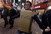 A Japanese man wearing a very makeshift Gundam costume enjoys Halloween celebrations in Shibuya. Saturday October 28th 2017