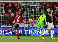 24th November 2019; Bramall Lane, Sheffield, Yorkshire, England; English Premier League Football, Sheffield United versus Manchester United; Lys Mousset of Sheffield United runs to celebrate after he scores in the 52nd minute to make it 2-0 with Harry Maguire of Manchester United close by - Strictly Editorial Use Only. No use with unauthorized audio, video, data, fixture lists, club/league logos or 'live' services. Online in-match use limited to 120 images, no video emulation. No use in betting, games or single club/league/player publications