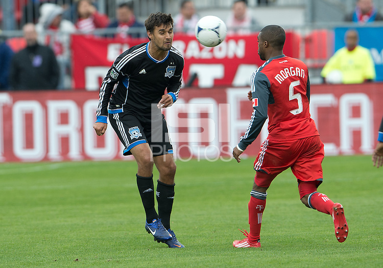 24 March 2012: San Jose Earthquakes forward Chris Wondolowski #8 and Toronto FC defender Ashtone Morgan #5 in action during the second half in a game between the San Jose Earthquakes and Toronto FC at BMO Field in Toronto..The San Jose Earthquakes won 3-0..