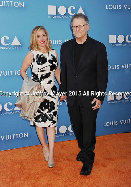 LOS ANGELES, CA - MAY 30: Actor Albert Brooks (R) and artist Kimberly Shlain arrive at the 2015 MOCA Gala presented by Louis Vuitton at The Geffen Contemporary at MOCA on May 30, 2015 in Los Angeles, California.