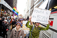"Hundreds of protesters march early in the morning on November 17, 2011 in New York City with the aim to shut down Wall Street and the Stock Exchange.  The action was the first in a day of protests celebrating the two month anniversary of the ""Occupy Wall Street"" movement.  While many workers were inconvenienced by the human (and police) barricades, the Stock Exchange opened on schedule."