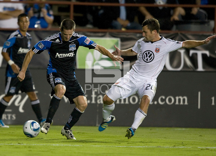 Sam Cronin of Earthquakes controls the ball away from Stephen King of DC United during the game at Buck Shaw Stadium in Santa Clara, California on July 30th, 2011.   DC United defeated San Jose Earthquakes, 2-0.