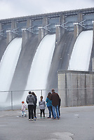 NWA Democrat-Gazette/FLIP PUTTHOFF <br /> BEAVER DAM RELEASE<br /> MIke Jansson (right) of Farmington and his family watch Wednesday March 20 2019 the release of Beaver Lake water through three flood gates at the dam near Eureka Springs. The Army Corps of Engineers opened three of the seven flood gates six inches at 10 a.m. on Wednesday. Water is also being released through one hydroelectric generator. The dam's second generator is off line for repair. Total water release is 5,200 cubic feet per second, according to a corps' news release.