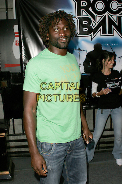 """PAUL SACKEY.""""Rock Band"""" video game launch at Bloomsbury Bowling Lanes, London, England. .May 13th, 2008.half length green t-shirt .CAP/AH.©Adam Houghton/Capital Pictures."""