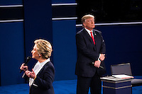 ST LOUIS, MO - OCTOBER 09: Republican presidential nominee Donald Trump (L) listens as Democratic presidential nominee former Secretary of State Hillary Clinton speaks during the town hall debate at Washington University on October 9, 2016 in St Louis, Missouri. This is the second of three presidential debates scheduled prior to the November 8th election.