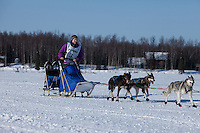 Kaye Berg on Willow lake heads towards the finish of the Jr. Iditarod   Willow, Alaska
