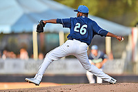 Asheville Tourists starting pitcher Frederis Parra (26) delivers a pitch during a game against the Charleston RiverDogs at McCormick Field on August 15, 2019 in Asheville, North Carolina. The Tourists defeated the RiverDogs 6-3. (Tony Farlow/Four Seam Images)