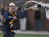 Moira Callahan #4 of Massapequa has a shot from point blank range turned away by Manhasset goalie Krissy Kowalski in the closing seconds of a Nassau County varsity girls lacrosse game at played at Manhasset High School on Tuesday, March 27, 2018. Manhasset won by a score of 11-8.