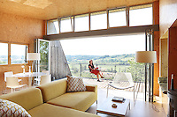 Architect Vicky Thornton enjoys the view from the balcony of the house she designed and built herself