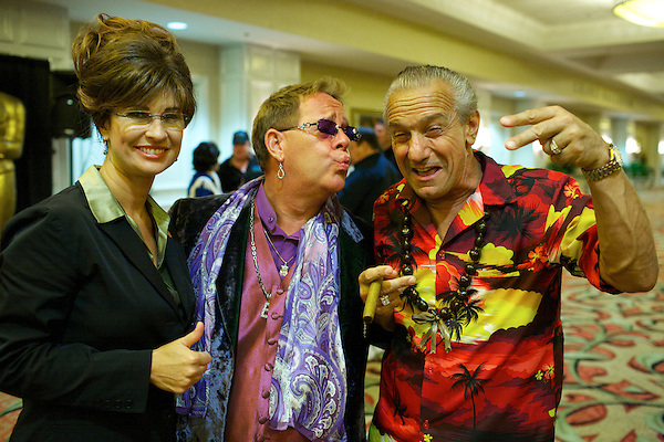 Sarah Palin, Elton John and Robert De Niro impersonators pose for photos