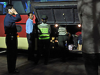 A bus is searched by armed border police at the MuCang checkpoint in Ruili, China. The police search everything and take the vehicles apart with screw-drivers in their search for the drugs.  Chinese-Burmese gangs smuggle drugs across the border from Muse, in Burma and smuggle them out of Ruili using drug mules. ...PHOTO BY SINOPIX