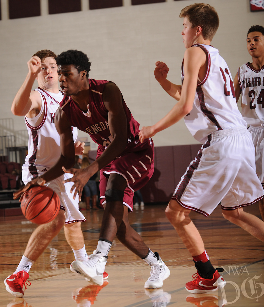 NWA Democrat-Gazette/ANDY SHUPE<br /> Towayne Bobo (center) of Springdale drives past Will Taylor (left) and Luke Fox of Tulsa (Okla.) Holland Hall Tuesday. Dec. 29, 2015, during the first half at Siloam Springs High School. Visit nwadg.com/photos to see more photographs from the game.