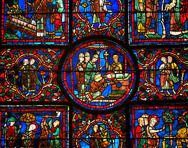 Medieval Windows of the Gothic Cathedral of Chartres, France, dedicated to St Martin of Tour.    A UNESCO World Heritage Site. In the  central oval panel St Martin is ordained Bishop of Tour.
