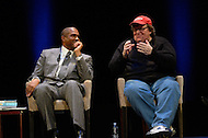January 12, 2012  (Washington, DC)  Radio and television talk show host Tavis Smiley (left) listens as filmmaker Michael Moore makes a point during a moderated discussion on restoring America's prosperity at the George Washington University Lisner Auditorium in Washington.  (Photo by Don Baxter/Media Images International)