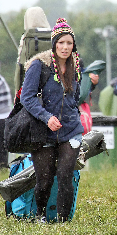 08/07/'10 Fans braving a shower pictured arriving at Punchestown, Co. Kildare this evening for the start of the Oxegen Festival 2010...Picture Colin Keegan, Collins, Dublin