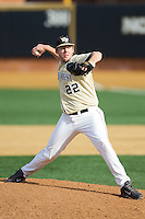 Wake Forest Demon Deacons relief pitcher Will Craig (22) delivers a pitch to the plate against the Marshall Thundering Herd at Wake Forest Baseball Park on February 17, 2014 in Winston-Salem, North Carolina.  The Demon Deacons defeated the Thundering Herd 4-3.  (Brian Westerholt/Four Seam Images)