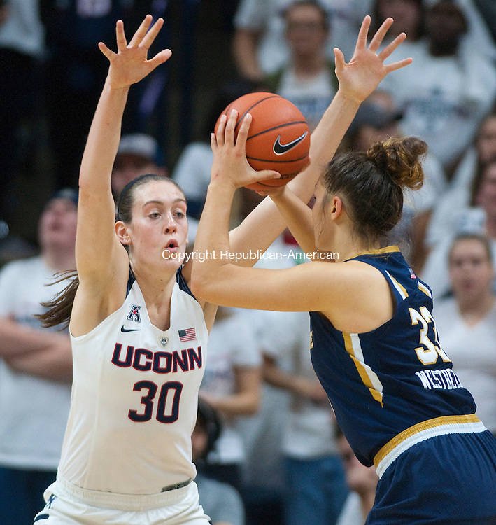 STORRS, CT--- -12015JS16--UConn's Breanna Stewart (30) plays tight defense on Notre Dame's Kathryn Westbeld (33) during their game Saturday at Gampel Pavilion in Storrs. <br /> Jim Shannon Republican-American