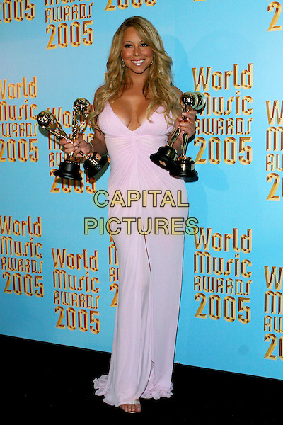 MARIAH CAREY.2005 World Music Awards-Press Room held at the Kodak Theatre, Hollywood, CA..August 31st, 2005.Photo credit: Jacqui Wong/AdMedia.full length awards trophy winner pink dress plunging neckline.www.capitalpictures.com.sales@capitalpictures.com.© Capital Pictures.
