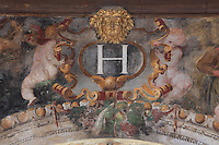 Fresco detail with initial H for Henri II, putti and a fruit garland, painted c. 1552 by Niccolo dell'Abatte after drawings by Primaticcio, in the Ballroom or Galerie Henri II, Chateau de Fontainebleau, France. The Palace of Fontainebleau is one of the largest French royal palaces and was begun in the early 16th century for Francois I. It was listed as a UNESCO World Heritage Site in 1981. Picture by Manuel Cohen