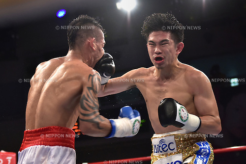(L-R) Pablo Carrillo (COL), Kazuto Ioka (JPN),<br /> SEPTEMBER 16, 2014 - Boxing :<br /> Kazuto Ioka of Japan hits Pablo Carrillo of Colombia in the ninth round during the 10R flyweight bout at Korakuen Hall in Tokyo, Japan. (Photo by Hiroaki Yamaguchi/AFLO)