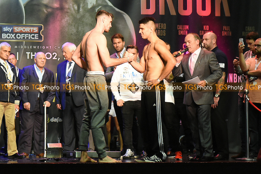 Boxers Callum Smith (L) and Norbert Nemesapati shake hands during a Weigh-In at the O2 Arena on 9th September 2016