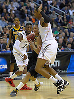 Michael Dixon of the Tigers is bumped by Tigers' Justin Jackson. Cincinnati defeated Missouri 78-63 during the NCAA tournament at the Verizon Center in Washington, D.C. on Thursday, March 17, 2011. Alan P. Santos/DC Sports Box