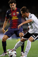 02/09/2012 - Liga Football Spain, FC Barcelona vs. Valencia CF Matchday 3 - Joao Pereira from Valencia CF controls the ball in front of Cesc Fabregas from FC Barcelona
