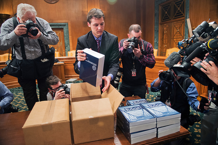 UNITED STATES - FEBRUARY 02: Eric Chalmers of the Senate Budget Committee, unpacks copies of President Obama's budget for fiscal year 2016, in Dirksen Building, February 2, 2015. (Photo By Tom Williams/CQ Roll Call)