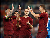 Calcio, Serie A: Roma, stadio Olimpico, 1 aprile, 2017.<br /> Roma's Edin Dzeko (r) celebrates after scoring with his teammates Radja Nainggolan (l) and Kostas Manolas (c) during the Italian Serie A football match between Roma and Empoli at Olimpico stadium, April 1, 2017<br /> UPDATE IMAGES PRESS/Isabella Bonotto