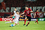 Shanghai FC Defender Wang Shenchao (L) trips up with Guangzhou Defender Li Xuepeng (R) during the AFC Champions League 2017 Quarter-Finals match between Guangzhou Evergrande (CHN) vs Shanghai SIPG (CHN) at the Tianhe Stadium on 12 September 2017 in Guangzhou, China. Photo by Marcio Rodrigo Machado / Power Sport Images