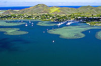 Aerial over Kaneohe Bay with Kaneohe yacht harbor and hillside near Kailua.