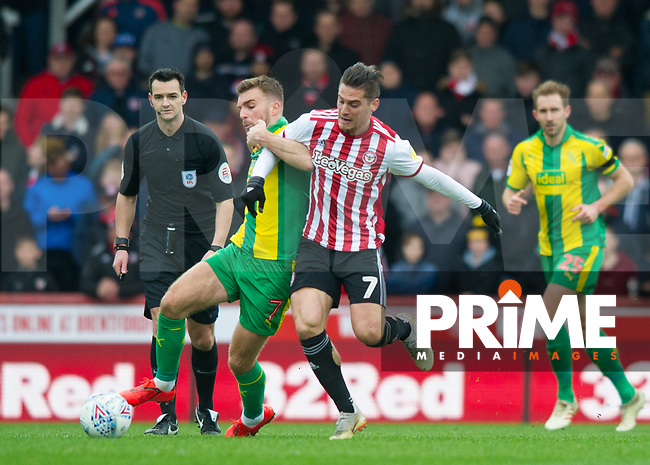 WBA's James Morrisonand Brentford Sergi Canos during the Sky Bet Championship match between Brentford and West Bromwich Albion at Griffin Park, London, England on 16 March 2019. Photo by Andrew Aleksiejczuk / PRiME Media Images.