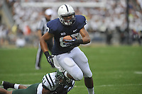 01 September 2012:  Penn State TE Kyle Carter (87) fights off a tackle by Ohio S Gerald Moore (13).  The Ohio Bobcats defeated the Penn State Nittany Lions 24-14 at Beaver Stadium in State College, PA.