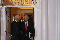 United States Vice President-elect Mike Pence shakes hands with Andrew Puzder, chief executive of CKE Restaurants, after meeting with President-elect Donald Trump (C), while leaving the clubhouse of Trump International Golf Club, November 19, 2016 in Bedminster Township, New Jersey. <br /> Credit: Aude Guerrucci / Pool via CNP /MediaPunch