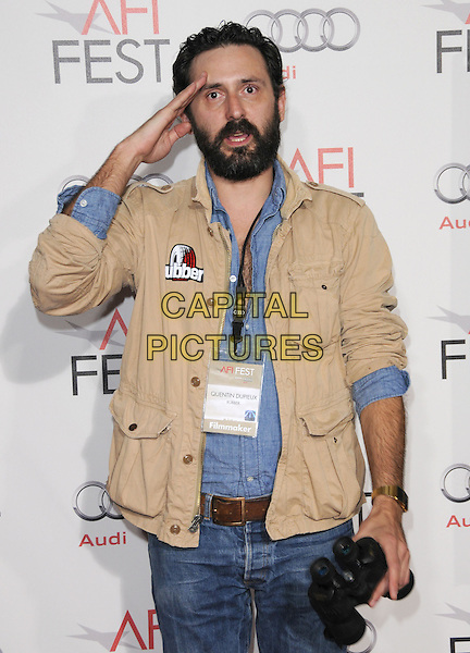 "QUENTIN DUPIEUX .Attends the AFI Fest 2010 Screening of ""The King's Speech"" held at The Grauman's Chinese Theatre in Hollywood, California, USA,.November 5th 2010..half length hand salute gesture beige jacket blue shirt beard facial hair              .CAP/RKE/DVS.©DVS/RockinExposures/Capital Pictures."