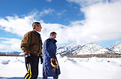 Jackson Hole, WY - February 9, 2002 -- United States President George W. Bush and friend Roland Betts walk a private trail along the Snake River in Jackson Hole, Wyoming, Saturday, February 9, 2002. The President and Mrs. Bush are staying the Jackson Hole residence of Roland and Lois Betts. The Grand Teton Mountains are shown in background.<br /> Mandatory Credit: Eric Draper / White House via CNP