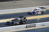 Apr. 14, 2012; Concord, NC, USA: NHRA funny car driver Cruz Pedregon (near lane) races alongside Matt Hagan during qualifying for the Four Wide Nationals at zMax Dragway. Mandatory Credit: Mark J. Rebilas-
