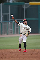 Jancarlos Cintron (3) of the Visalia Rawhide throws to first base during a game against the Modesto Nuts at Recreation Ballpark on June 10, 2019 in Visalia, California. (Larry Goren/Four Seam Images)