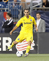Columbus Crew defender Sebastian Miranda (21) passes the ball. In a Major League Soccer (MLS) match, the New England Revolution defeated Columbus Crew, 2-0, at Gillette Stadium on September 5, 2012.