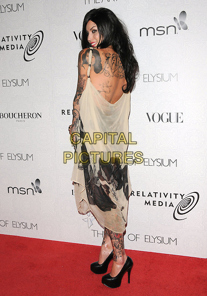 "KAT VON D aka Katherine Von Drachenberg.at Art of Elysium 3rd Annual Black Tie charity gala '""Heaven"" held at 990 Wilshire Blvd in Beverly Hills, California, USA, January 16th 2010 .                                                                  arrivals full length tattoos beige print black shoes dress platform sleeveless back rear behind over shoulder profile side .CAP/RKE/DVS.©DVS/RockinExposures/Capital Pictures"
