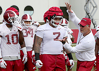 NWA Democrat-Gazette/DAVID GOTTSCHALK   Arkansas Razorback defensive coordinator Paul Rhoads works with defensive lineman Briston Guidry as they go through  drills Friday, July 28, 2017, during practice on campus in Fayetteville.